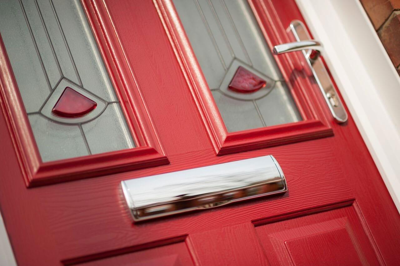 red composite door with brushed steel accessories