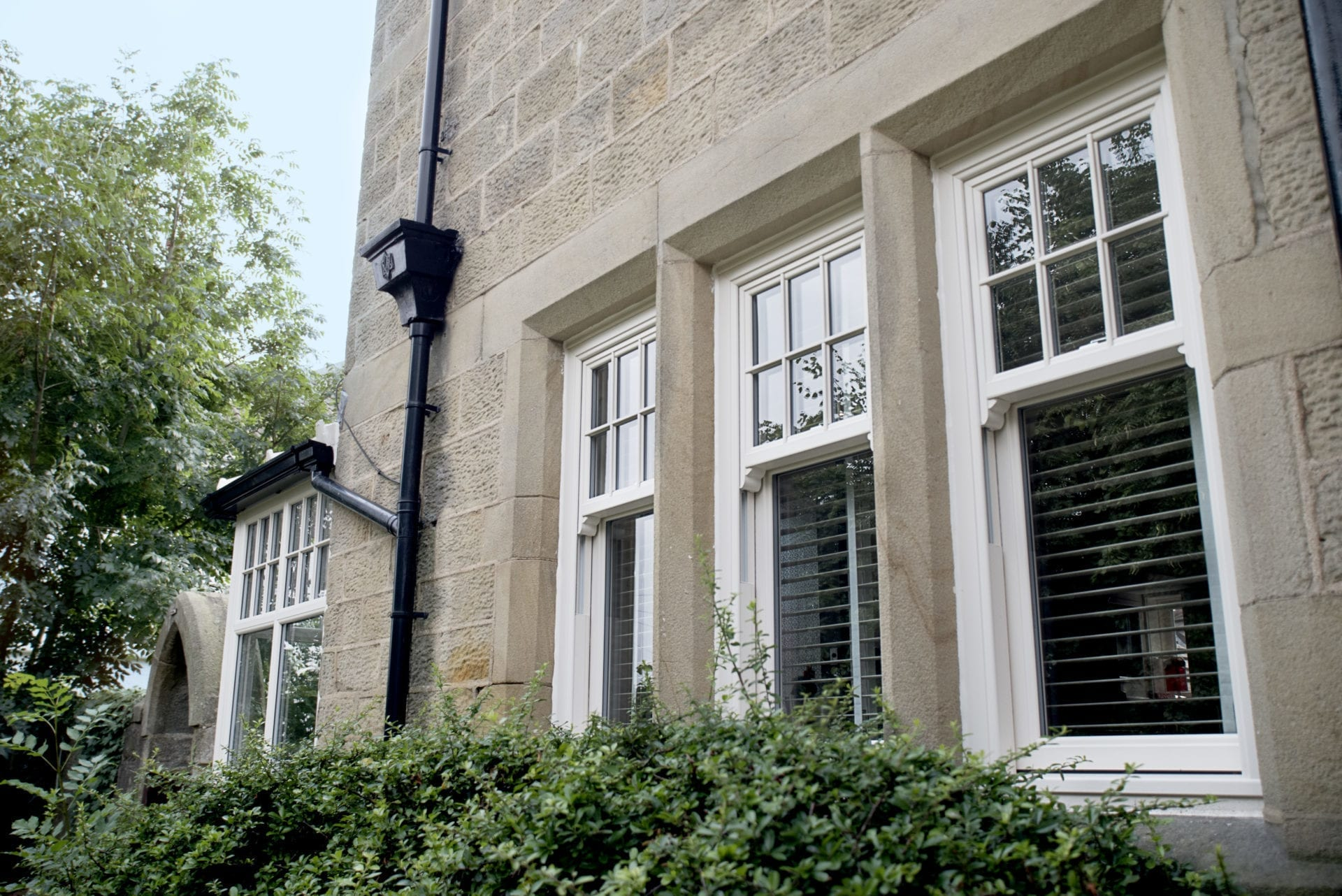 PVCu Sliding Sash Windows in Cream Woodgrain