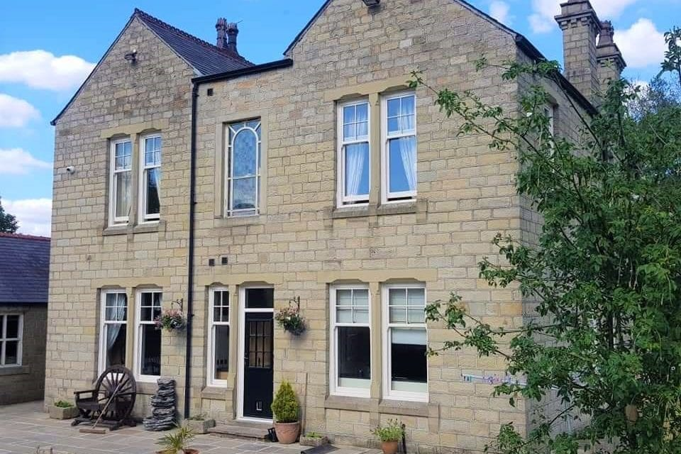 Traditional Edwardian Windows in a Modern Stone House