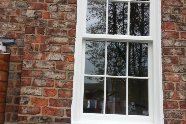 Arched Window on Brick Wall