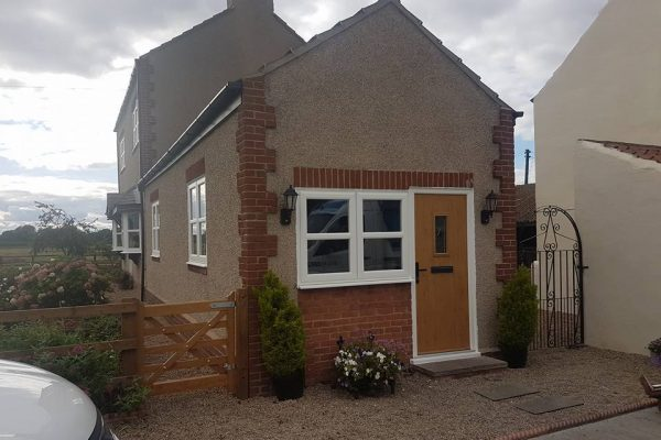 PVCu Casement Windows beside an oak Composite Door