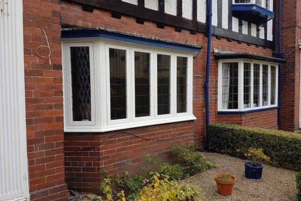 White PVCu Bay Windows on Tudor House