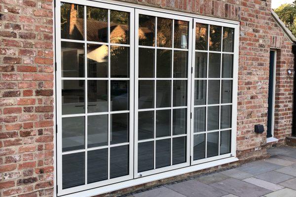 White Bi-folding Doors with flat bars