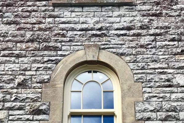 True arched Iconic Sash Windows with run-through horns and surface bars