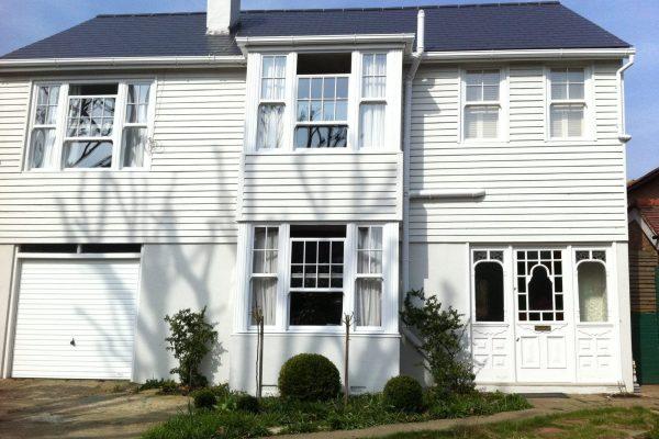 White Edwardian Windows on a Wooden House
